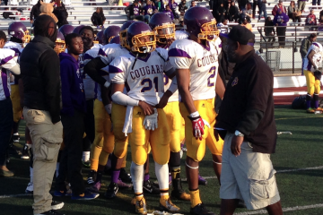 The MLK Cougars line up to congratulate the Archbishop Wood Vikings who defeated them 52-8 in the PIAA AAA District 12 Championship Game on Saturday. (Brian Hickey/WHYY)