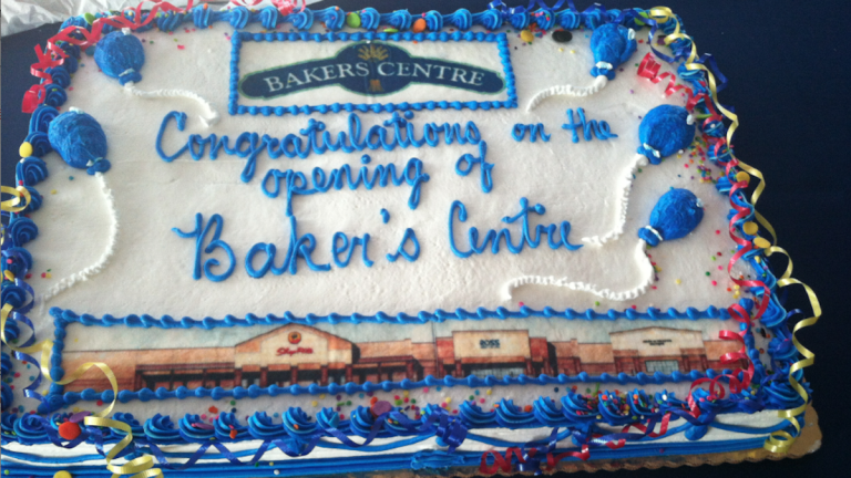 The atmosphere was so festive at the Bakers Centre ribbon-cutting event that few were likely to notice the errant apostrophe on the cake. (Laura Benshoff/for NewsWorks)