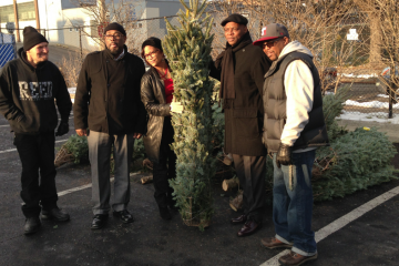 Terrance Smith (far right) said the Christmas-tree giveaway helped out during tough times. (Brian Hickey/WHYY)