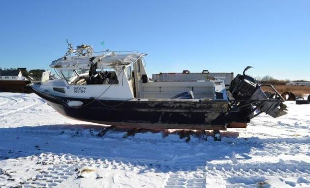 The boat occupied by beach replenishment surveyors that capsized off Sea Girt Saturday morning. (Image: Sea Girt Police Department)