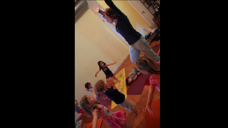 Sophie Simpson teaches toddlers yoga at Blue Banyan Yoga in Mt. Airy (Michelle Zei/for NewsWorks, file)