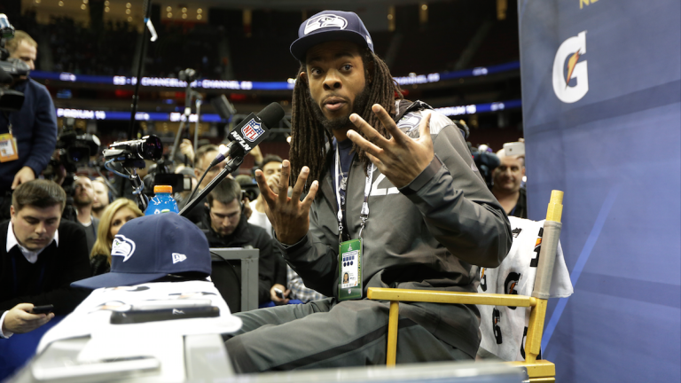 Seattle Seahawks' Richard Sherman answers a question during media day for the NFL Super Bowl XLVIII football game Tuesday in Newark, N.J. (AP Photo/Jeff Roberson)