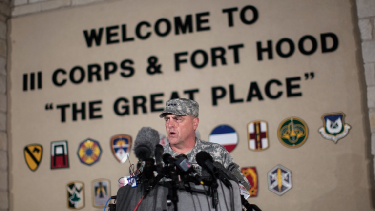 Lt. Gen. Mark Milley, commanding general of III Corps and Fort Hood, speaks with the media outside of an entrance to the Fort Hood military base following a shooting that occurred inside, Wednesday, April 2, 2014, in Fort Hood, Texas. Four people were killed, including the gunman, and 16 were wounded in the attack, authorities said. (AP Photo/Tamir Kalifa)
