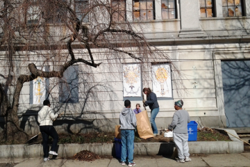 Volunteers gathered at Germantown Town Hall on Saturday to rake and bag leaves, sticks and winter debris, tossing piles of discarded bottles and cans into blue recycling bins. (Alaina Mabaso/for NewsWorks)