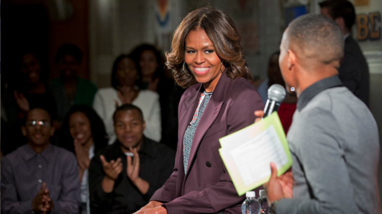 First lady Michelle Obama  on Thursday joined juniors and seniors from Chicago public high schools on the first day of their four-day visit to Howard University, as part of a program to immerse talented high school students in a college campus environment. (AP Photo/Jacquelyn Martin)