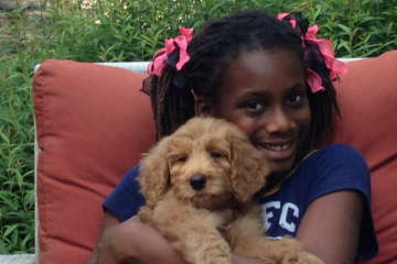 Jen Bradley's daughter with their dog when it was a puppy. (Courtesy of Jen Bradley)