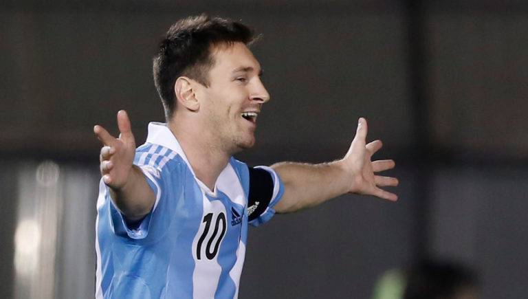 Argentina's Lionel Messi celebrates after scoring against Paraguay during a World Cup qualifying soccer game in Asuncion, Paraguay. Players with a Manayunk youth-soccer program will head to Brazil to watch Messi and the world's greatest players compete next month. (AP Photo/Jorge Saenz, File)