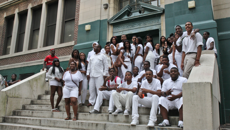 On June 18, 2013, members of the last class posed outside Germantown High School before taking a ceremonial last lap around the building. (Bas Slabbers/for NewsWorks)