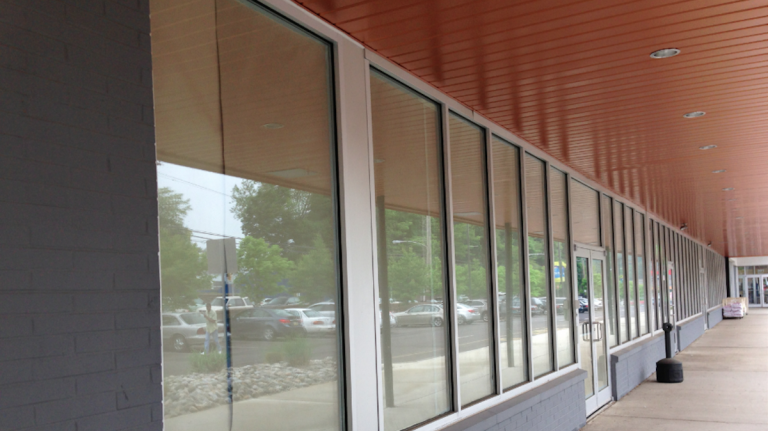 Once heralded as a 'tipping point' for Germantown revitalization, windows at the Citibank branch in Chelten Plaza are now papered over. (Brian Hickey/WHYY)