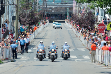 Police made their presence known at the 2011 bike race in Manayunk. Reports of rowdiness have dwindled in subsequent years. (Bas Slabbers/for NewsWorks)