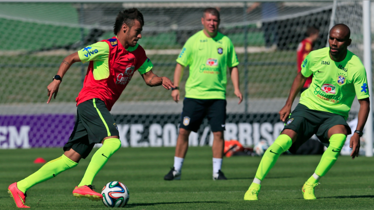 Brazil's Neymar, left, dribbles the ball against Maicon during a practice session at the Granja Comary training center in Teresopolis, Brazil, on Thursday. Brazil and Croatia will face off in the opening match on June 12. (AP Photo/Hassan Ammar)