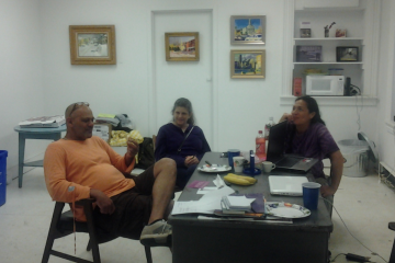 Gallery co-owners Renny Molenaar and Rocio Cabello talk with artist Jill Saull (middle). (Alaina Mabaso/for NewsWorks)