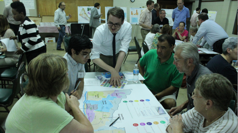 Kevin Hunter, of the city Commerce Department, leads residents in a discussion of planning issues on Thursday night. (Matt Grady/for NewsWorks)