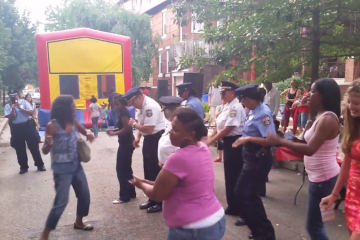 At one of numerous National Night Out events across the city, police and residents got their groove on in West Philly on Tuesday night. (Photo courtesy of Philadelphia Police)