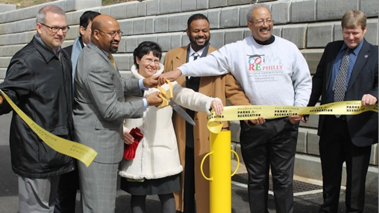 Mayor Michael Nutter and U.S. Rep. Chaka Fattah hold oversized scissors at the 2013 ribbon cutting for the Shawmont Trail project in Northwest Philadelphia. (NewsWorks, file art)