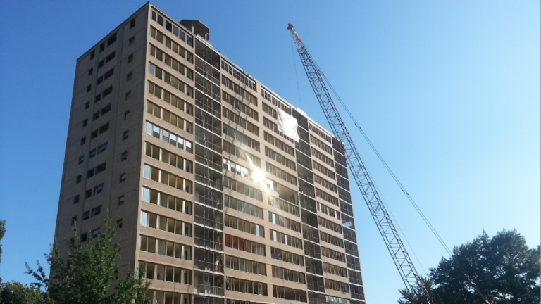 The sun reflects off a Queen Lane Apartments tower that is scheduled for implosion on Sept. 13. (Aaron Moselle/WHYY)