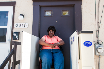 Brenda Jessie lives across the street from the Queen Lane Apartments tower. She says change in the neighborhood is long overdue. (Brad Larrison/for NewsWorks)