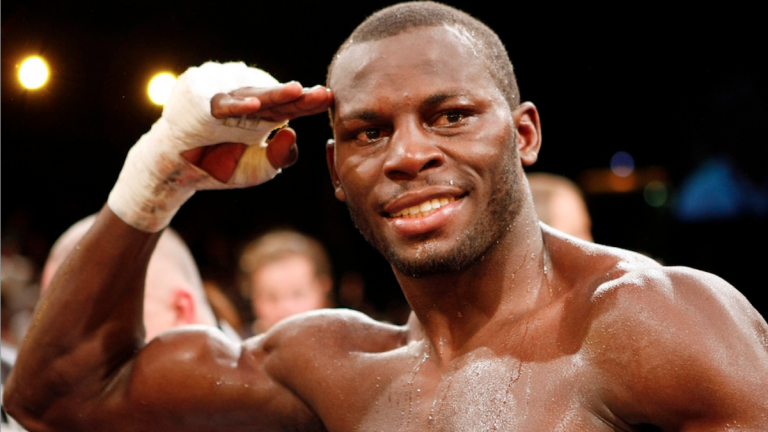 Steve 'USS' Cunningham from the USA, picture, salutes after a victory in the boxing ring. He and his family will soon be honored by Philadelphia City Council. (AP Photo/Martin Meissner)