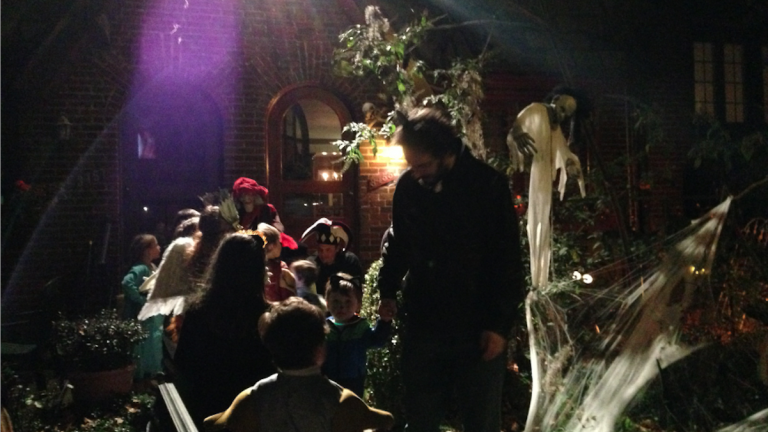 Trick-or-treaters were out in full force around the time of the collision. (Brian Hickey/WHYY)