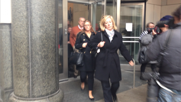 Kathryn Knott (center), one of three defendants charged in connection with an alleged 'gay bashing' incident in Center City, leaves the courthouse Tuesday afternoon. (Brian Hickey/WHYY)