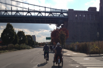Bicyclists riding on Delaware Avenue's unprotected bike lane. (Dena Driscoll/for NewsWorks)