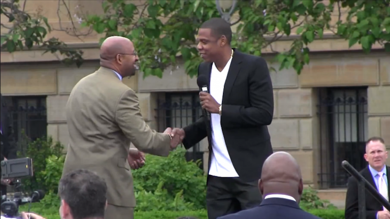 Mayor Michael Nutter took to a luncheon stage to a song by Jay-Z, pictured here announcing his Parkway music festival. (Image via YouTube)
