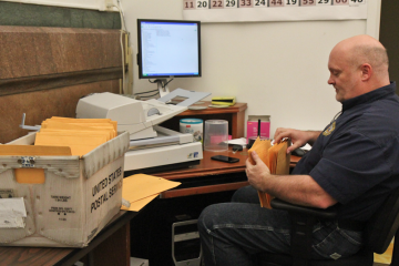 Monday's annual-report filing deadline means the Philadelphia County Board of Elections' office is rather busy. (Kimberly Paynter/WHYY)