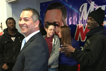 Seventh District council candidate Manny Morales flanked by supporters at Friday's press conference in his Hunting Park Avenue campaign office. (Brian Hickey/WHYY)