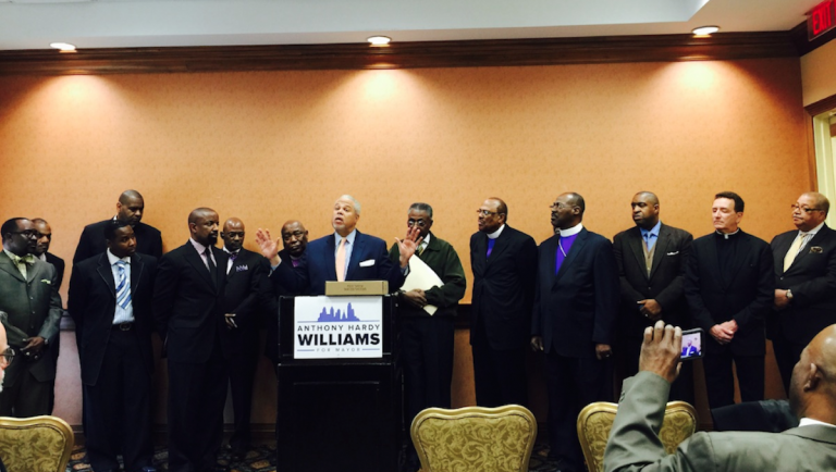 State Sen. Anthony Williams accepts the endorsement of a collection of faith-based leaders on Friday. (Brian Hickey/WHYY)