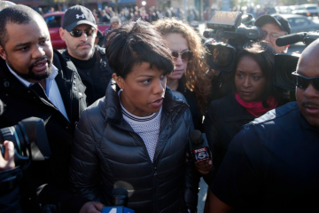 Baltimore Mayor Stephanie Rawlings-Blake tours the city on Tuesday in the aftermath of rioting following Monday's funeral for Freddie Gray, who died in police custody, in Baltimore. (AP Photo/Matt Rourke)