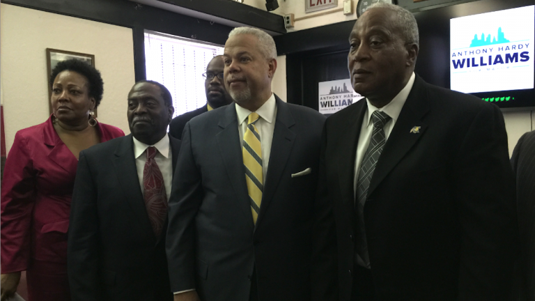 Mayoral candidate Anthony Hardy Williams accepts the Guardian Civic League endorsement, flanked by group president Rochelle Bilal, former Fire Commissioner Lloyd Ayers and former Police Commissioner Sylvester Johnson. (Brian Hickey/WHYY)