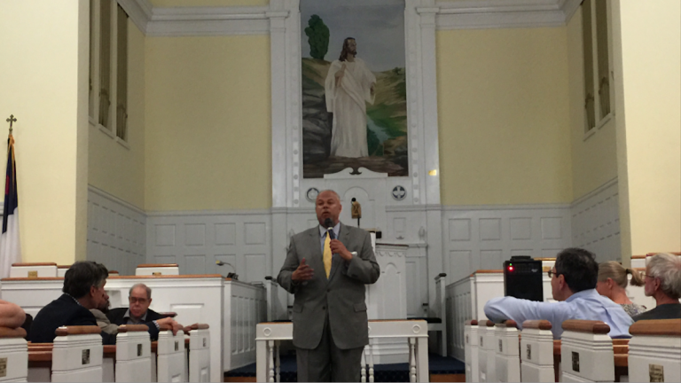 Mayoral candidate Anthony Hardy Williams fields questions during a mayoral forum at East Falls Presbyterian Church on Monday night. (Brian Hickey/WHYY)