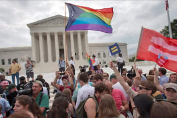 The crowd reacts as the ruling on same-sex marriage was announced outside of the Supreme Court on Friday. (AP Photo/Jacquelyn Martin)