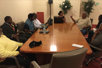 A group of faith leaders, and Milton Street, formalize plans for their Wednesday protest at City Hall. (Brian Hickey/WHYY)