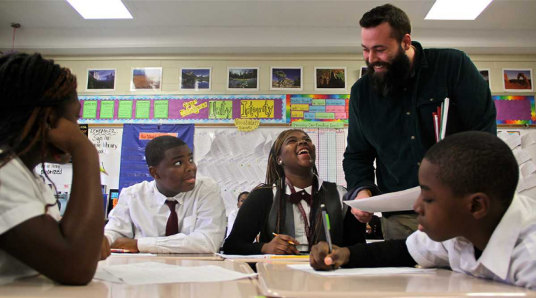 Teacher Andrew Brooking works with students at Blaine Elementary School in Philadelphia. (Emma Lee/WHYY)
