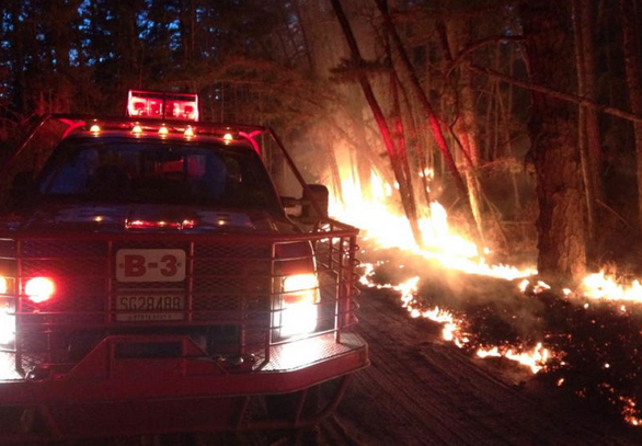 A New Jersey Forest Fire Service truck on the sceneof the 'Devious Mount' wildfire in Wharton State Forest in early April 2014. Crews contained the forest fire, which consumed 1,600 acres in a remote area, within approximately 24 hours.