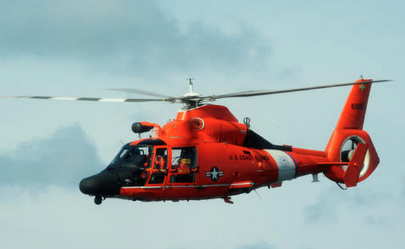 A Coast Guard file photo of a MH-65 Dolphin helicopter, which was used in the search for Renee Lopez, 30, who apparently fell overboard from a commercial fishing boat Wednesday morning. The Coast Guard called off the search Thursday morning.
