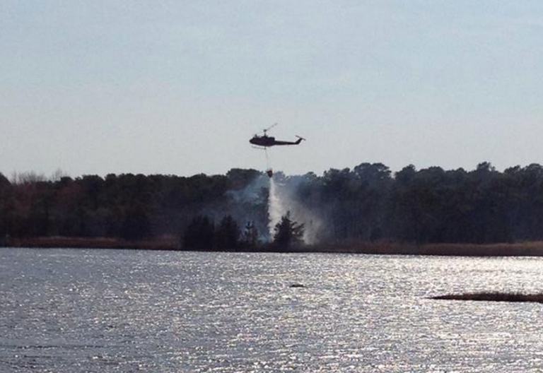 A New Jersey Forest Fire Service helicopter dropping water over a wildfire off Jordan Road in Brick Sunday afternoon. (Photo: Jersey Shore Hurricane News contributor Josh Bickert)