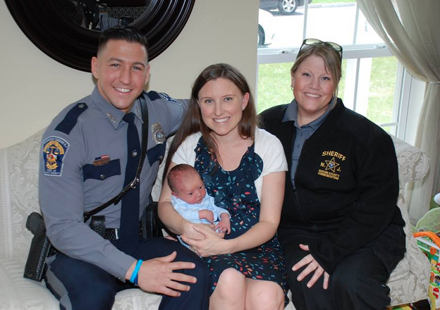Ofc. Joseph Fastige, Dawn Roach, 31, and her newborn son, Jason O'Jon Roach Jr., and Ocean County Sheriff's Department Telecommunicator Alia Hartman. (Photo courtesy of the Manchester Police Department)
