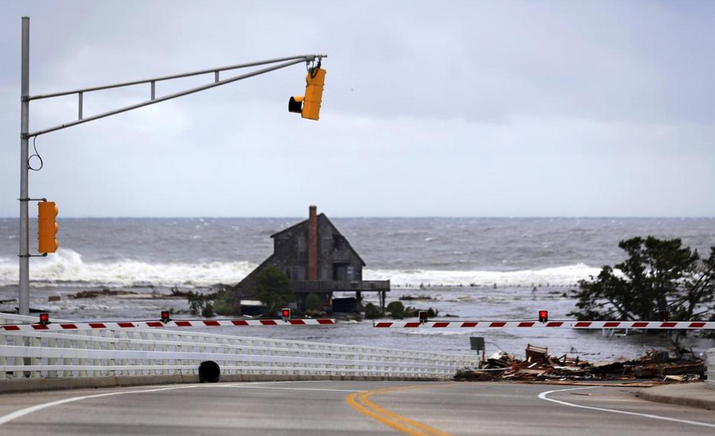 A lone home stood near the Mantoloking Bridge in Mantoloking after Superstorm Sandy's storm surge inundated the area in late October 2012. (Photo: Associated Press)