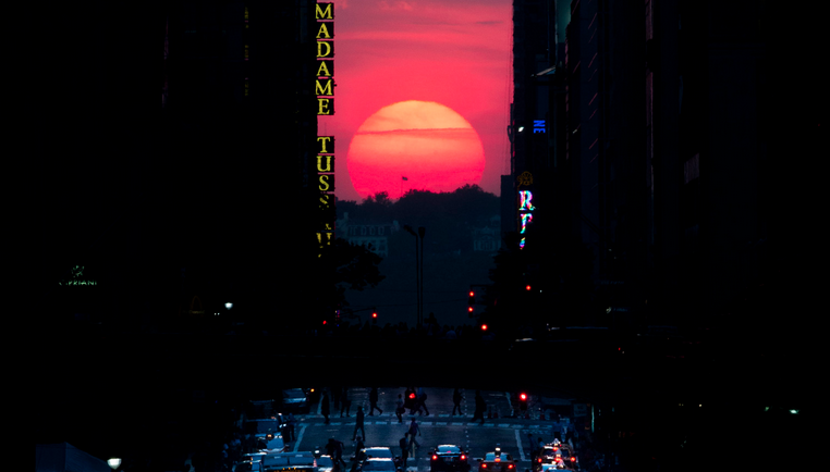 The sun sets along 42nd Street in Manhattan during an annual phenomenon known as