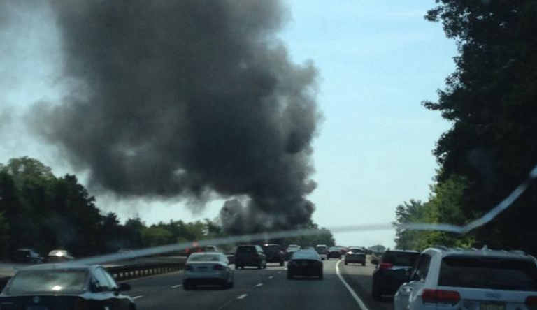 The smoke column emanating from a vehicle fire on the Garden State Parkway southbound express lane at milepost 105.5 late Monday morning. (Photo: Kyle Higham via Twitter  ‏@notoriousHIG_)