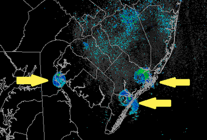 The yellow arrows point to birds depicted on a radar image shortly after sunrise last Sunday. (Image courtesy of the National Weather Service office in Mount Holly, NJ)