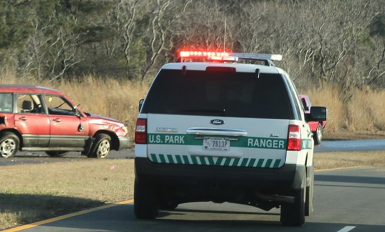A U.S. Park Ranger on the scene of a two vehicle crash this afternoon in Sandy Hook. One of the vehicles in the crash is on the left. Photo courtesy of JSHN contributor Bill Senck.