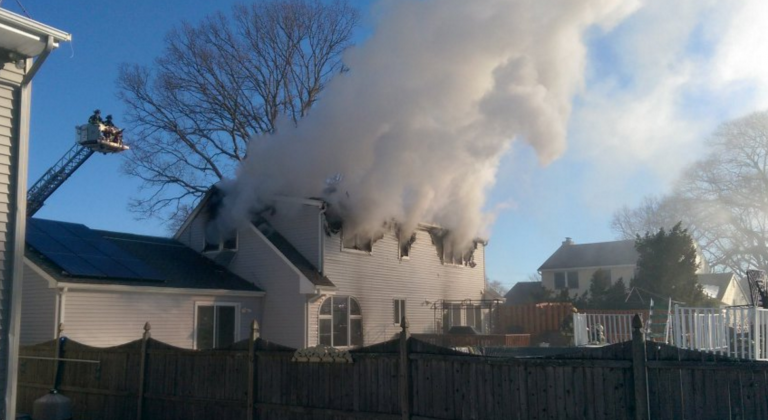 Smoke billowing out of a house on Miller Road in Point Pleasant this morning. (Photo courtesy of NJ Fire Incidents - @wt2fd via Twitter)
