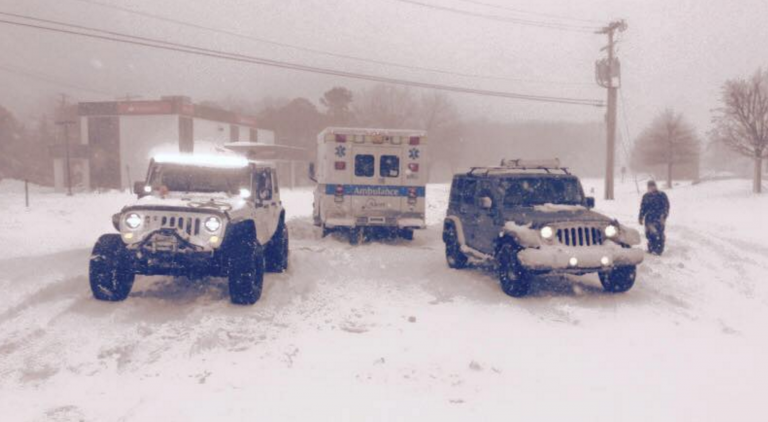 Two Jersey Shore Jeepers club members assisting a stuck ambulance during last week's blizzard. (Photo courtesy of Jersey Shore Jeepers)