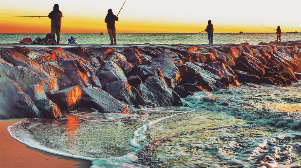 Anglers at sunrise along a jetty in Asbury Park at sunrise today. (Photo: @suzanne_ap via Instagram as tagged #JSHN)