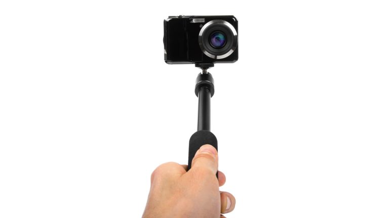 The Selfie Stick is perhaps the perfect illustration of society's growing compulsion to post. (Shutterstock photo)