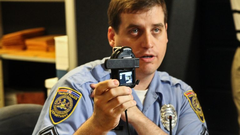 SEPTA Transit Police Sgt. Timothy Catto demonstrates how the new body-mounted camera works. (Kimberly Paynter/WHYY)