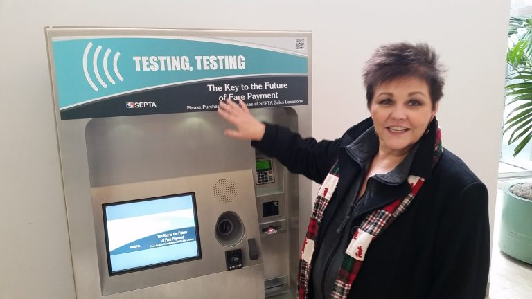 Leslie Hickman explains features of the new SEPTA sales kiosk. (Tom MacDonald/WHYY)